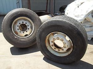 425 65R22 5 Goodyear Used Truck Tires 2 Mounted on Rims One Tire Is Likely Bad