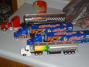 Lot of 4 Larger Semi Trucks Tractor Trailers BP Gas Kenworth Toys Diecast