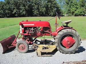 Farmall Cub with 5ft Finish Mower Snow Blade Tire Chains