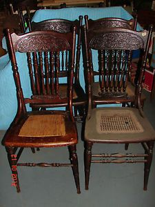 4 Matching Oak Pressed Back Chairs Early 1900's Lion Heads Facing Each Other