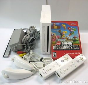 Nintendo Wii Game System Bundle with New Super Mario Bros Wii Accessories