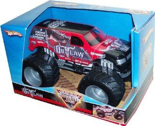 "Hot Wheels Monster Jam 124 Scale Die Cast Official Monster Truck 2008 Series   IRON OUTLAW with Monster Tires, Working Suspension and 4 Wheel Steering   Dimension  7"" (L) x 5"" (W) x 4 1/2"" (H) Toys & Games"
